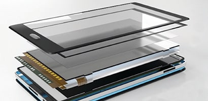 An image of the many layers of a mobile device including a high performance adhesive layer.