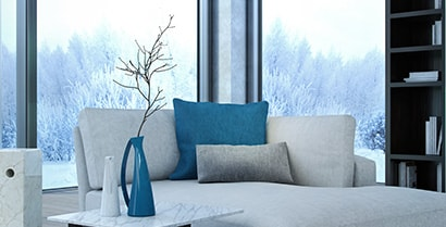 The view of a wintery scene from the family room window is a reminder that window films can help keep the cold outside.