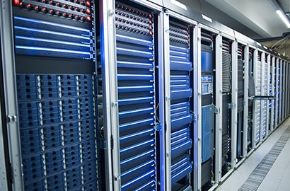 A room full of server racks with blue covers. Effective fire suppression for server rooms helps keep businesses up and running.