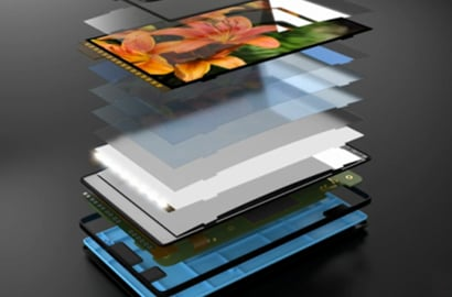 An image of a tablet broken apart into layers.