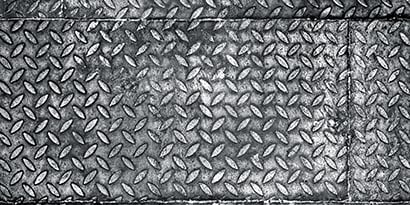 Plates of corrugated steel (diamond pattern) in industrial manufacturing