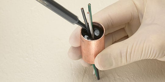 Adhesive flows over and around a component