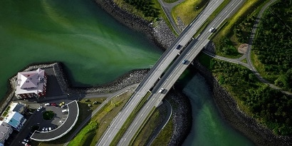 Helicopter view of a countryside bridge.