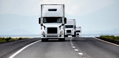 Trucking industry - three white semis