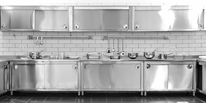 Stainless steel kitchen cabinets in a commercial kitchen