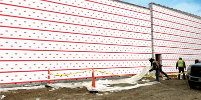Person working on a building using 3M™ Vapor Permeable Air Barrier 3015VP