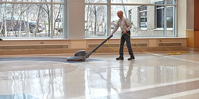 Man providing floor care with 3M products
