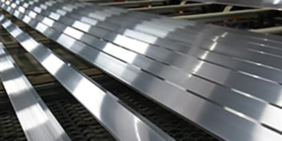 Strips of aluminum ready for metal adhesive