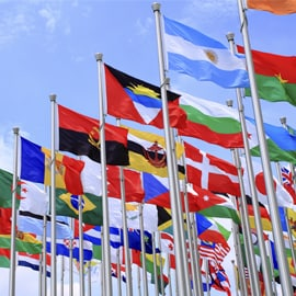 Flags of the world against a blue sky.